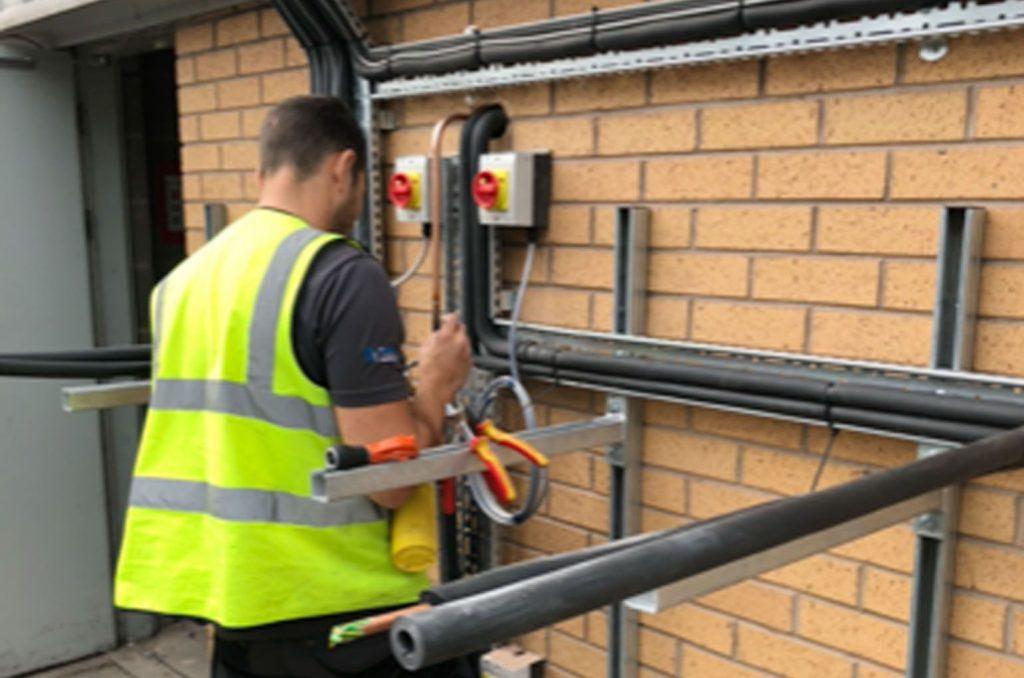 apprentice installing air conditioning